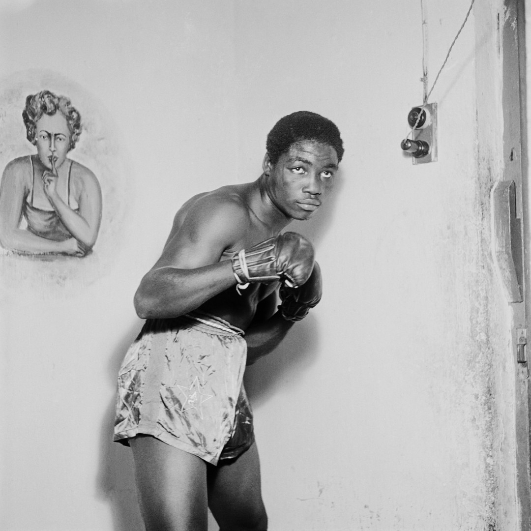 James Barnor, Ginger Nyarku Featherweight boxer with Coronation Belt, Accra, 1953. Gelatin silver print, 30 x 30. Courtesy of Autograph ABP.