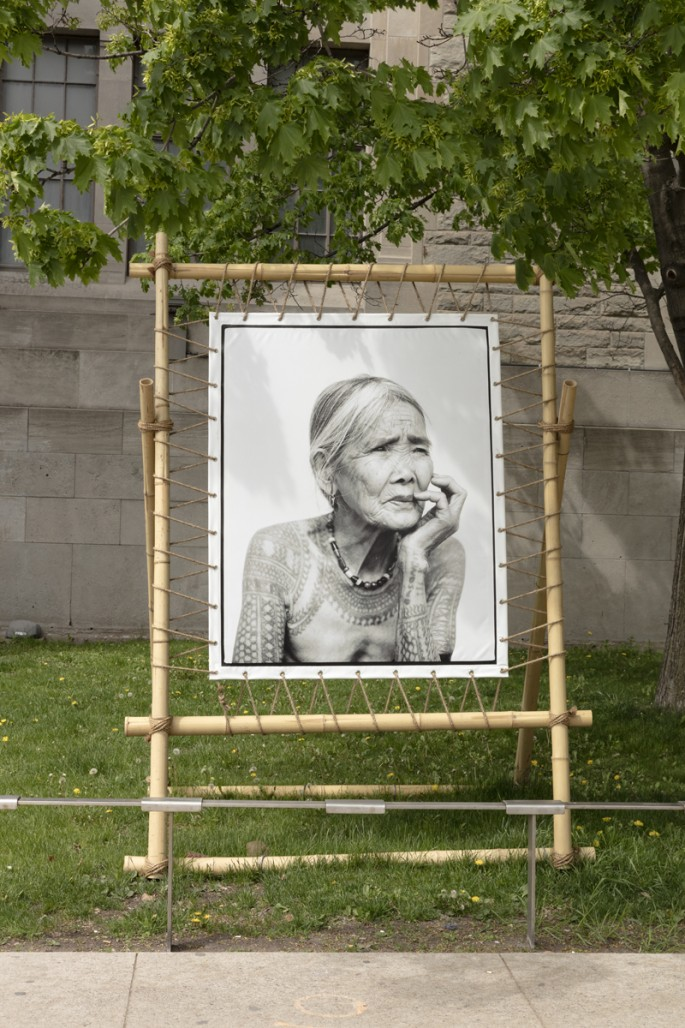 Installation view of Jake Verzosa's, </span><span><em>The Last Tattooed Women of Kalinga</em>, </span><span>Photo: Toni Hafkenscheid