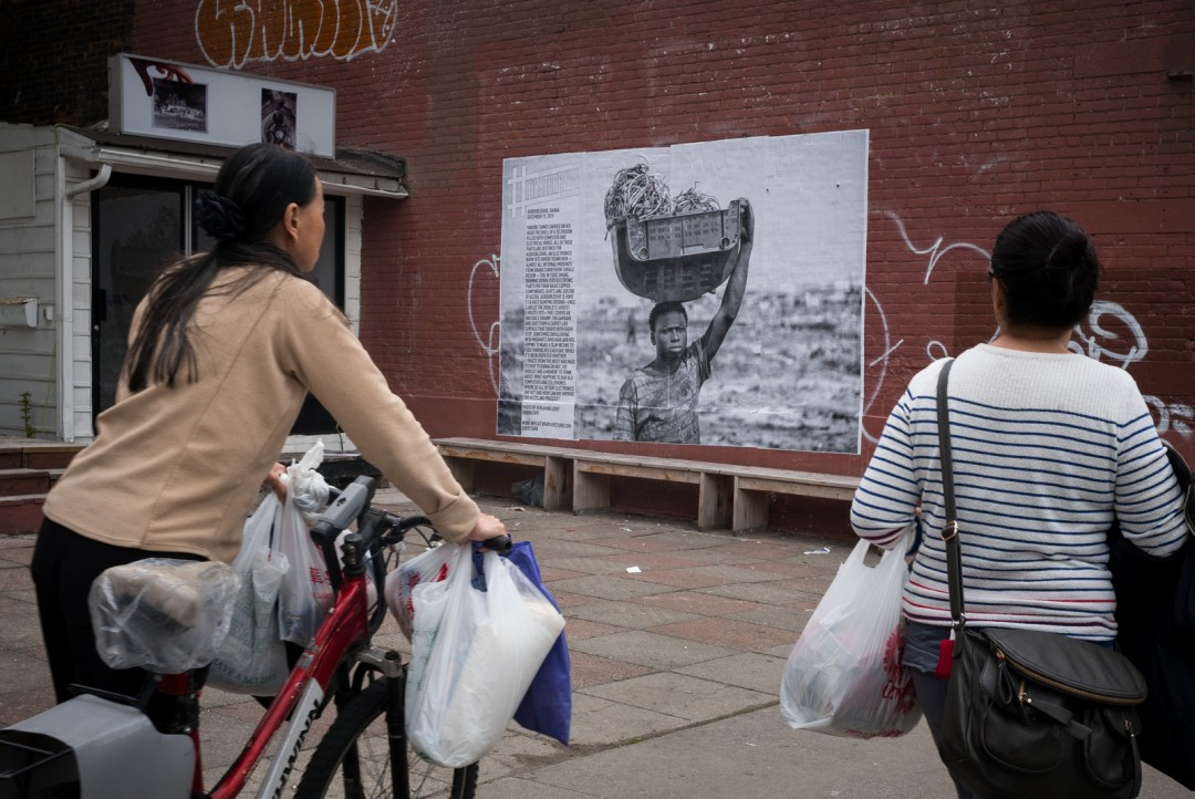 A photograph by Ben Lowy installed in front of 8eleven Gallery at 233 Spadina Avenue, Toronto. , Photo: Benjamin Petit
