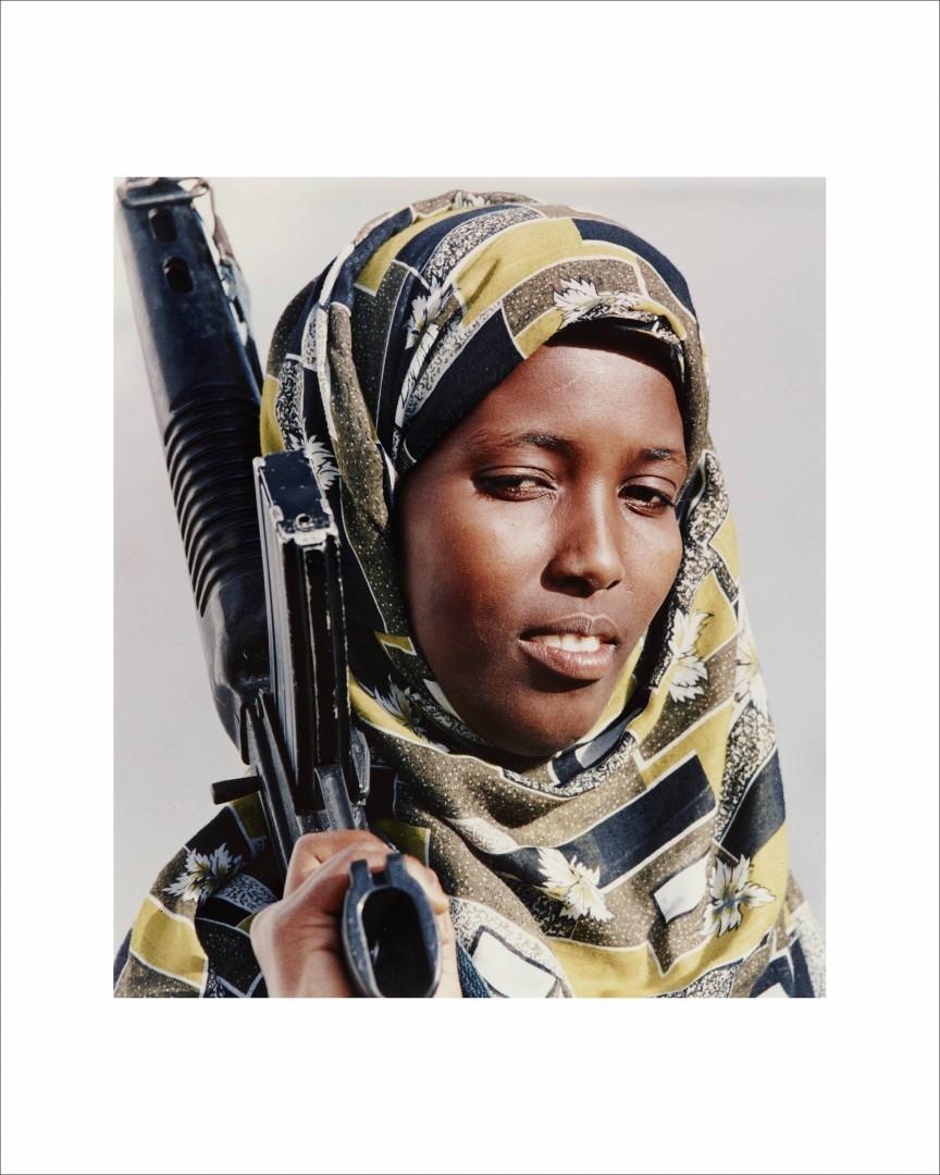 Dan Eldon, Untitled (Somali woman holds a rifle), 1992