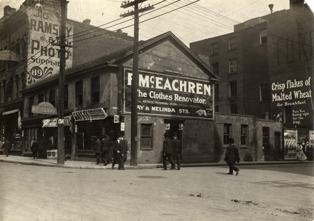 Toronto Public Library, </span><span><em>Bay Street Storefronts</em>, </span><span>1909