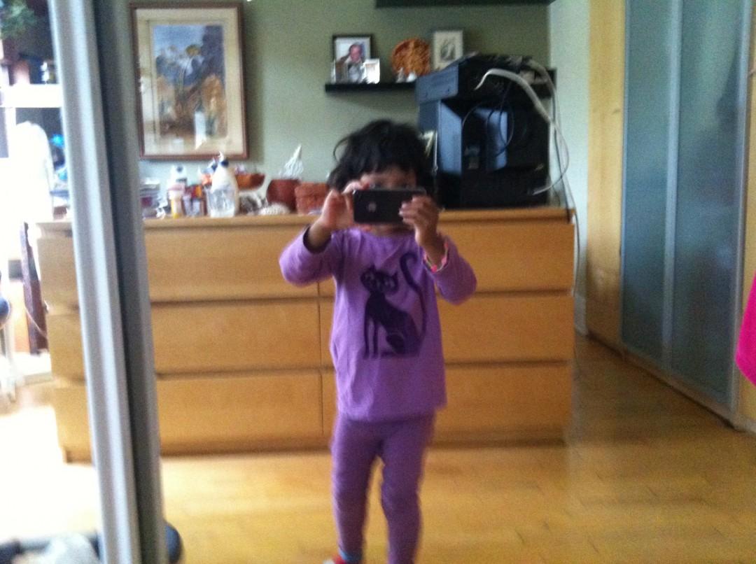 <em>Leena taking a self-portrait in a mirror</em>, </span><span>c. 2011