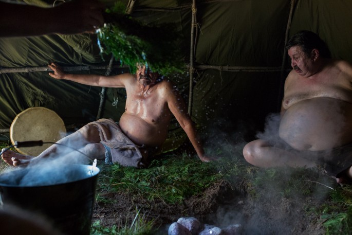Allen Agostino, </span><span><em>Garden River Reserve, Ontario, Canada. Members of the Garden River Fire Department relax in between rounds of a Sweat Lodge. The fire department uses the sweat lodge to deal with issues related to PTSD.</em>, </span><span>September 24, 2016