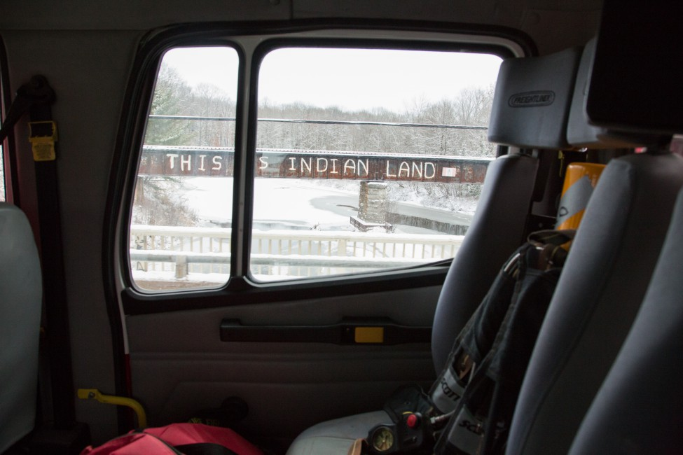 "Allen Agostino, </span><span><em>Garden River Reserve, Ontario, Canada. A shot of ""This Is Indian Land"" bridge from Garden Rivers  fire departments tanker 1. The bridge has become a sign of resistance for aboriginal Canadians.</em>, </span><span>November 24, 2016"