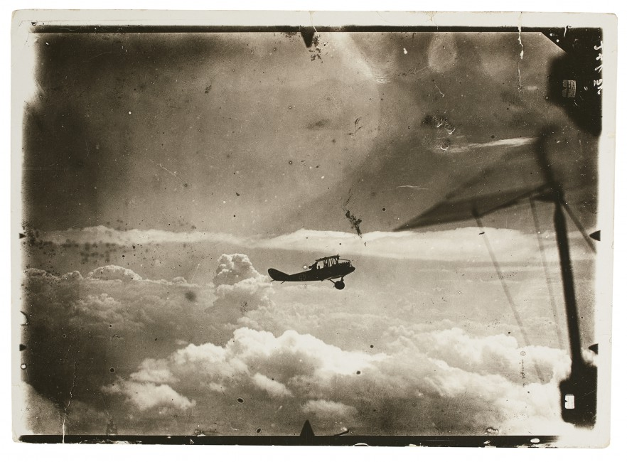 Unknown German, </span><span><em>Silhouette of airplane in flight</em>, </span><span>c. 1914 – 1918. Silver gelatin print.