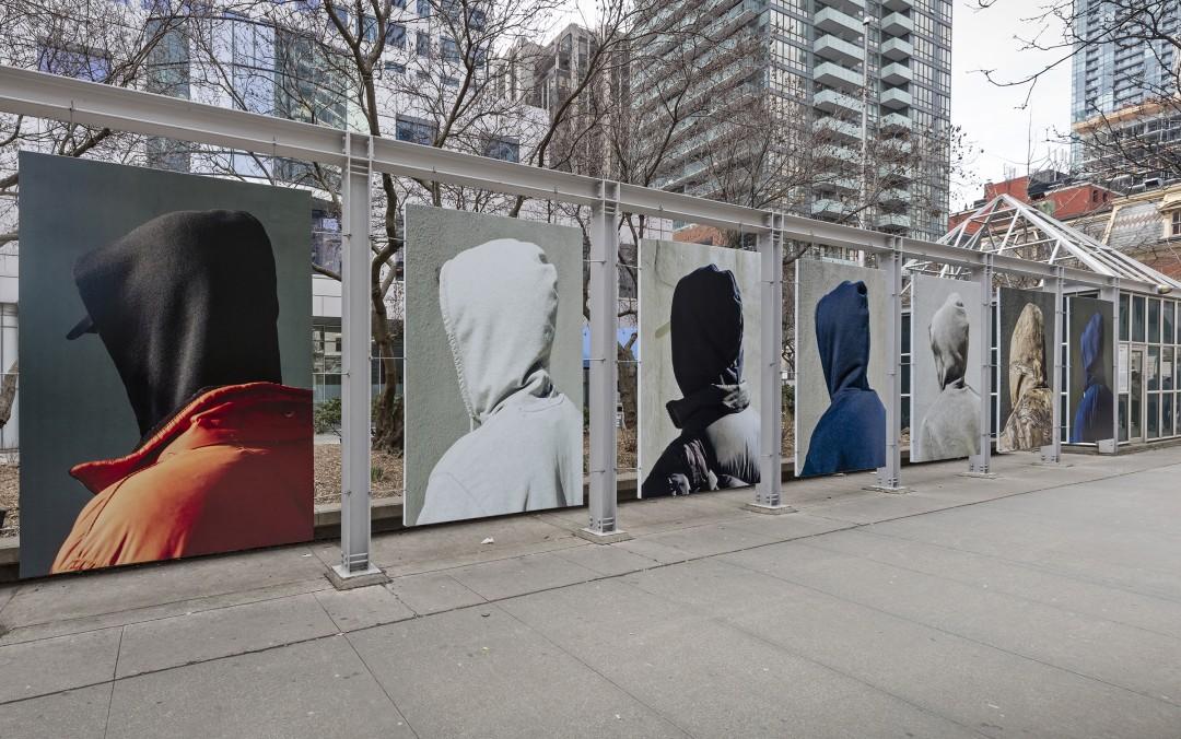 John Edmonds, </span><span><em>Hoods</em>, </span><span>2018. Installation at Metro Hall. Photo by Toni Hafkenscheid