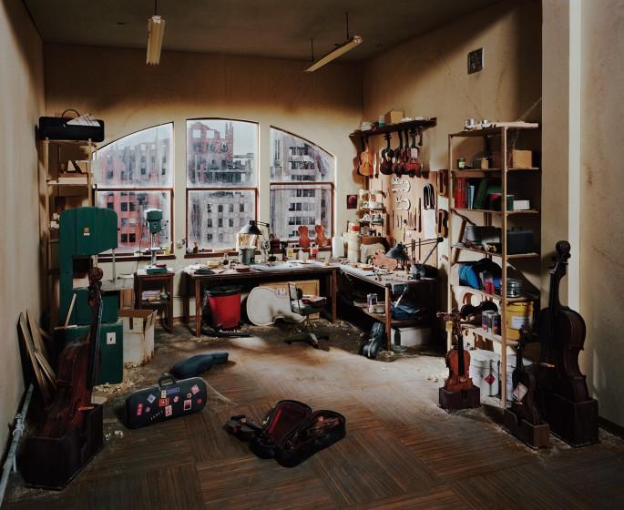 "Lori Nix and Kathleen Gerber, </span><span><em>Violin Repair Shop</em>, </span><span>2011. Chromogenic Print, 48 x 65"". Courtesy of Bau-Xi Photo."
