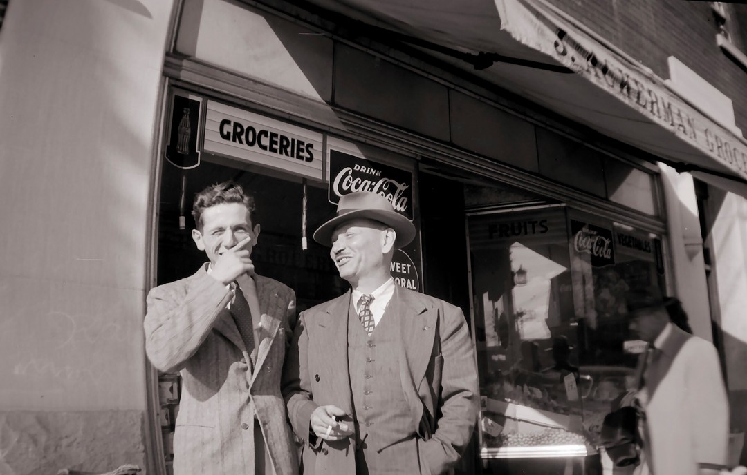 """John E. Ackerman, Men outside Ackerman's Grocery Store, C. 1940. Archival pigment print, 5 x 7"""". © Ontario Jewish Archives, Blankenstein Family Heritage Centre (UJA Federation), accession 2013-7-13"""