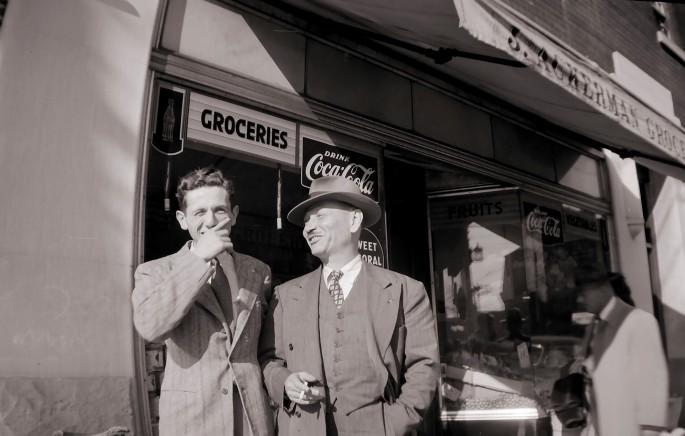 "John E. Ackerman, </span><span><em>Men outside Ackerman's Grocery Store</em>, </span><span>C. 1940. Archival pigment print, 5 x 7"". © Ontario Jewish Archives, Blankenstein Family Heritage Centre (UJA Federation), accession 2013-7-13"