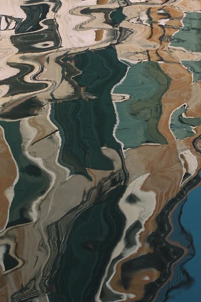 "Tess Roby, </span><span><em>Reflection, Venice</em>, </span><span>2017. Archival pigment print, 28 x 42""."