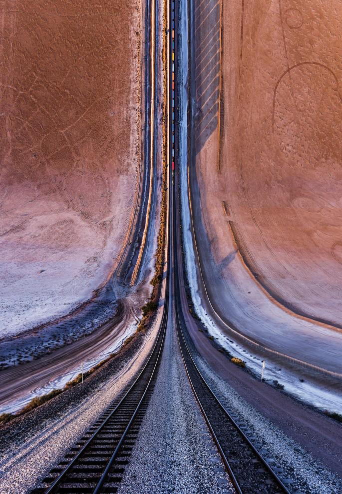 "Aydin Büyüktas, </span><span><em>Desert Railroad</em>, </span><span>2017. Chromogenic print, 47"" x 68""."