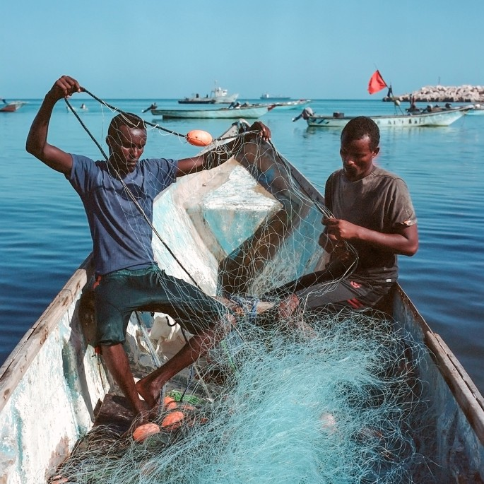 Nichole Sobecki, </span><span><em>Ahmed and Hamza untangle their nets</em>, </span><span>May 2016. Archival pigment print, 20 × 20&quot;.