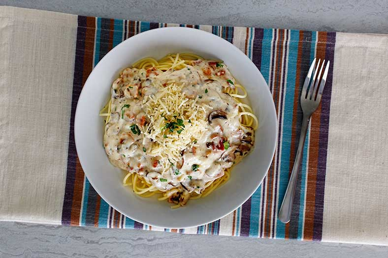 Enjoy a bowl of copycat Olive Garden Spaghetti Carbonara when you make this dish at home.