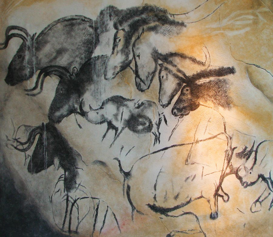 Paintings of rhinos and other large herbevoirs.