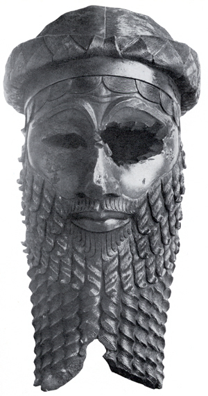 Stylized sculpture of a ruler's head. Time has done some damage to the sculpture, especially the left eye, but overall it has been well preserved.