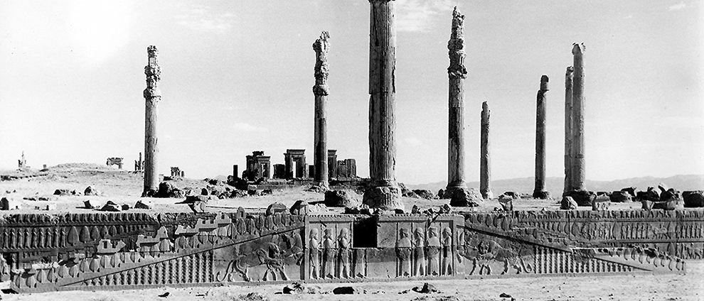 Ruins of the city. The frieze at the front of the city is mostly whole, and several large columns still stand.