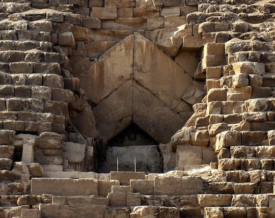 The entrance has four large stone above it creating a double layered inverted-V shape above the entrance.