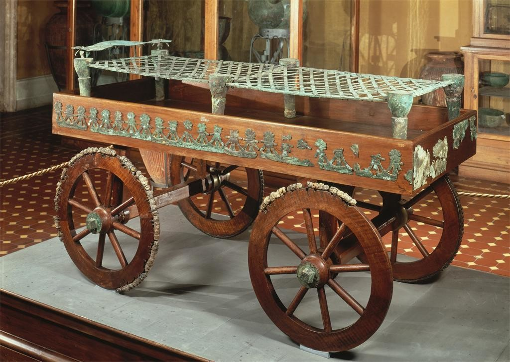 The bed is on a wheeled carriage.