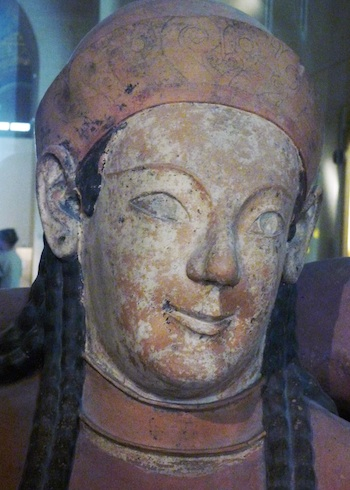 Close up of the woman's face in this carving. Her face has been painted white.