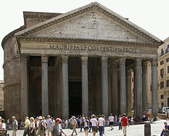 A picture taken in modern days; tourists can be seen in front of the large building.