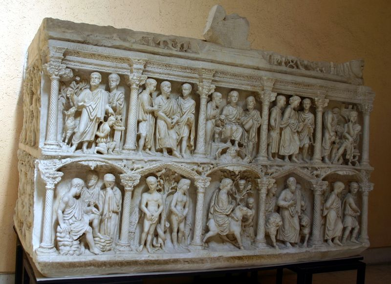 A plaster cast of the original sarcophagus. This replication shows 10 different scenes from the bible including Adam and Eve in front of the tree and Daniel in the Lions' Den