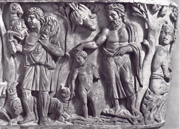 This portion of the sarcophagus features a young shepherd with a sheep held over his shoulders, its forelegs on one side of his neck and its hindlegs on the other. In this carving portion an older man is pointing at the shepherd and seemingly talking to his son about the shepherd.