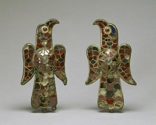 These fibulae are shaped like eagles with a shield or sun emblem on their backs