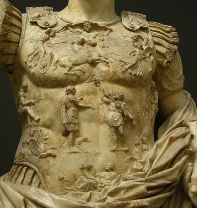 Up close photograph of the statue's breastplate. All features visible are discussed in the body text.