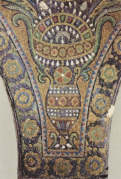 Intricate depiction of a vase with flowers in it. The vase design is layered and repetitive.