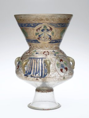 The lamp has a clear glass bottom and the top portion is opaque. This portion has geometric designs; the detail on the lamp is not as detailed as has been seen on walls.