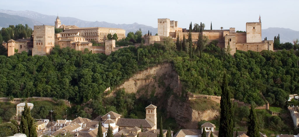 A complex of palaces on top of a hill; the architecture is more angular and rectangular than previous examples.