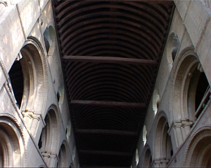 This ceiling is an example of simple barrel vaulting. The wooden beams support the ceiling and are not particularly decorative.