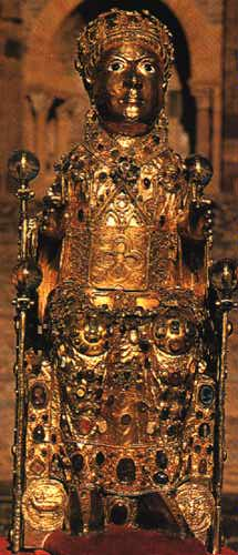 A gold plated statue of a saint holding a wine glass in each hand. The head of the reliquary contains a piece of skull which has been authenticated.