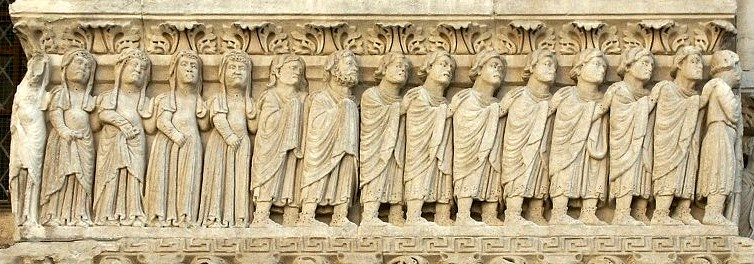 A row of individuals each with their hand on the shoulder of the person in front of them.