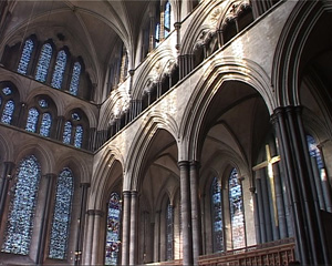 One of the cathedral aisles being illuminated with natural external light.