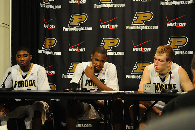 Three Purdue University basketball players answering questions at a panel.