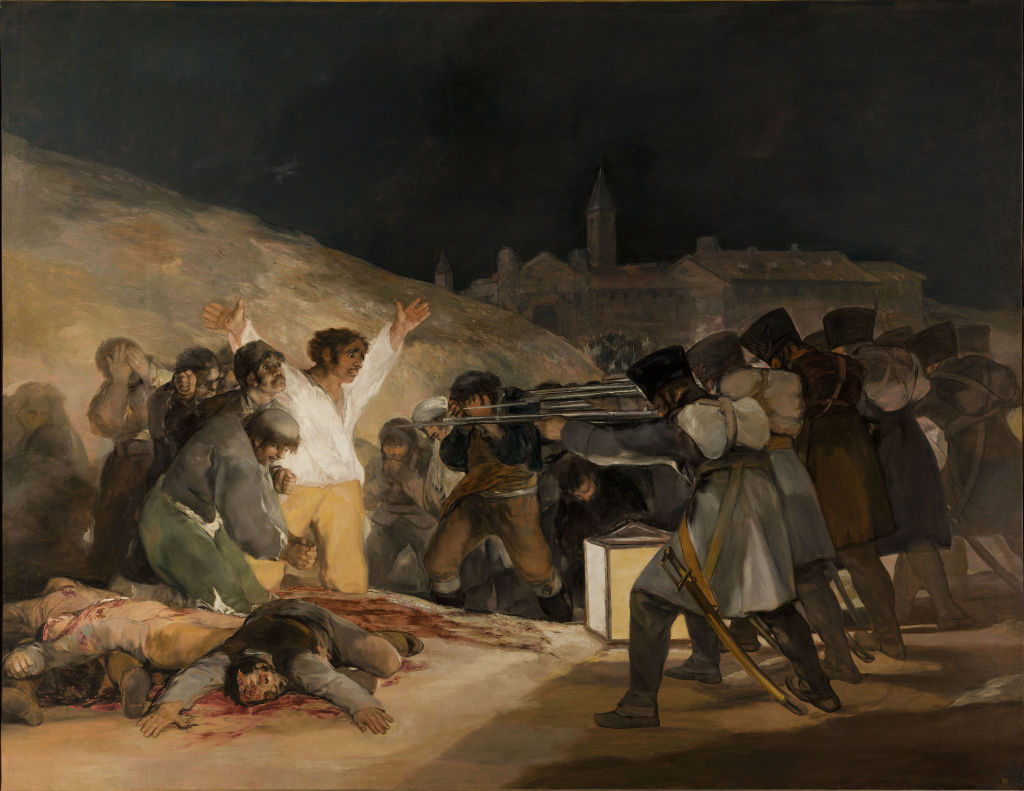 A group of terrified civilians face a firing squad of soldiers; several bloody dead comrades lie at the civilians' feet.