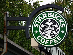 Photo of a Starbucks storefront sign.