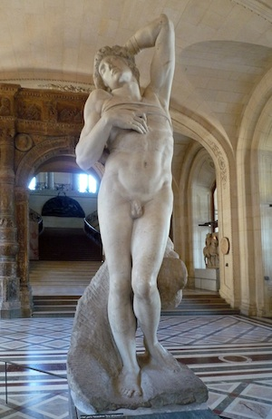 A nude marble sculpture of a slave. He is leaning backwards with his legs both bent. The form of the sculpture is incredible realistic.