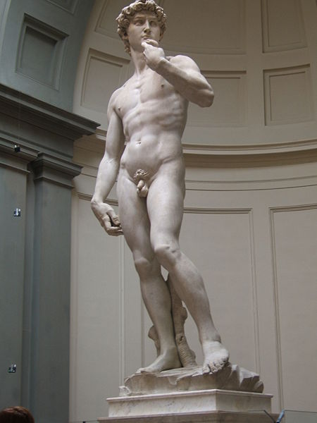 David stands nude in a contrapposto stance. His hand is brought up, and he is holding a sling.