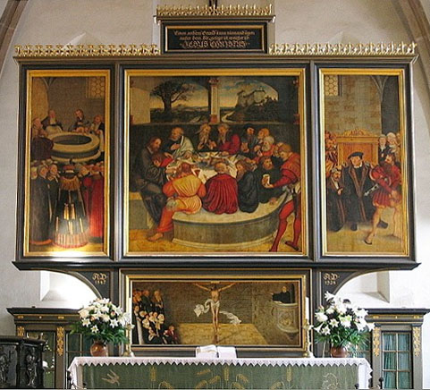 A triptych altarpiece. The left panel depicts a baptism. The right panel depicts a confession. The center panel depicts the last supper. In a painting below the triptych, we see the crucifix.