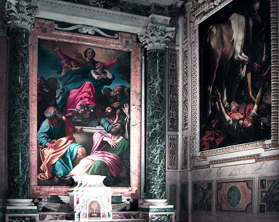 Two paintings are shown in this photograph of the chapel. Each painting has an intricately carved frame. The Assumption is also flanked with corinthian columns carved from marble.