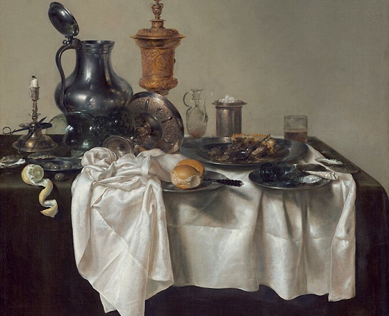 An almost photo-realistic still life painting. There is a dinner table topped with dishes and what appears to be the remnants of a large meal. The table cloth has been partially removed from the table. The scrunched and folded material drapes in extremely realistic ways.