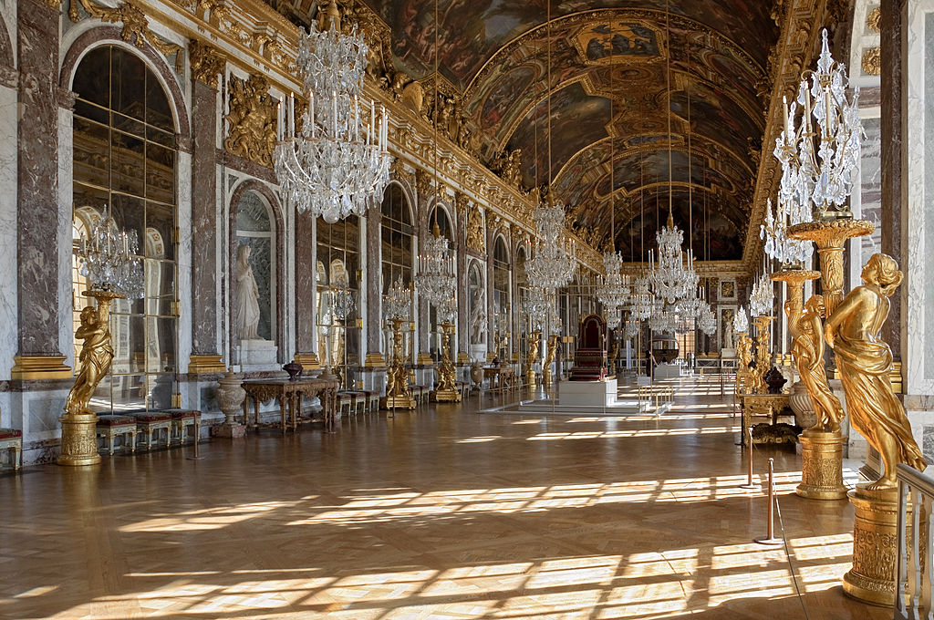 The hall is intricately decorated with chandeliers, murals, and golden statues.