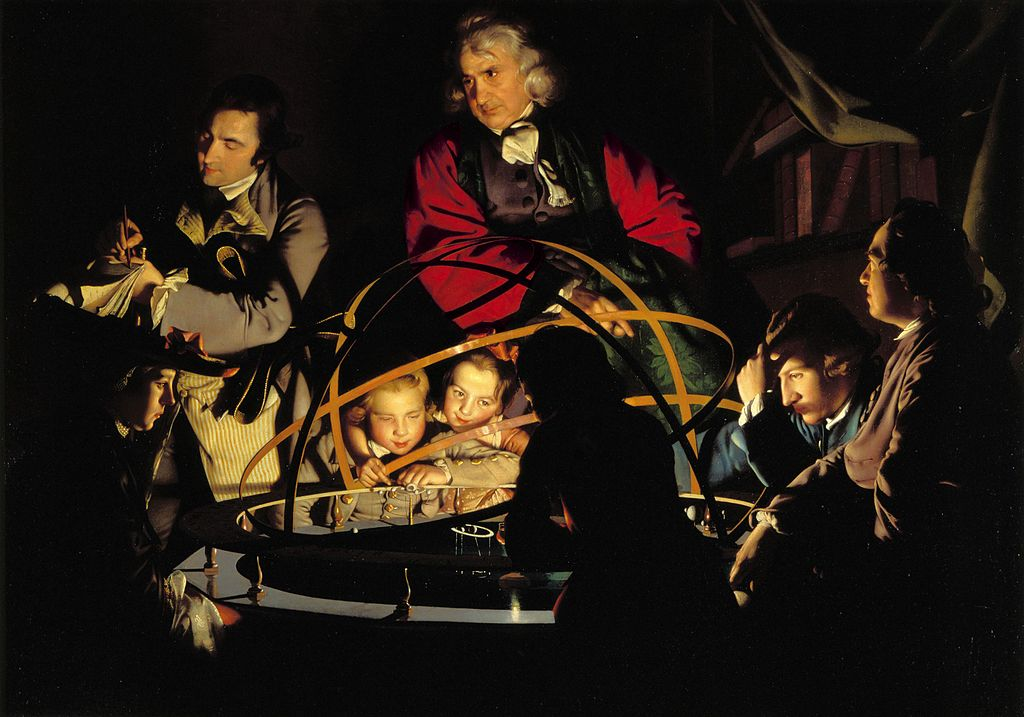 A group of men and boys around an orrery. The light of the orrery illuminates the figures facing us, while those on the other side of the orrery (the same side as the viewer) are backlit, and shadowed.