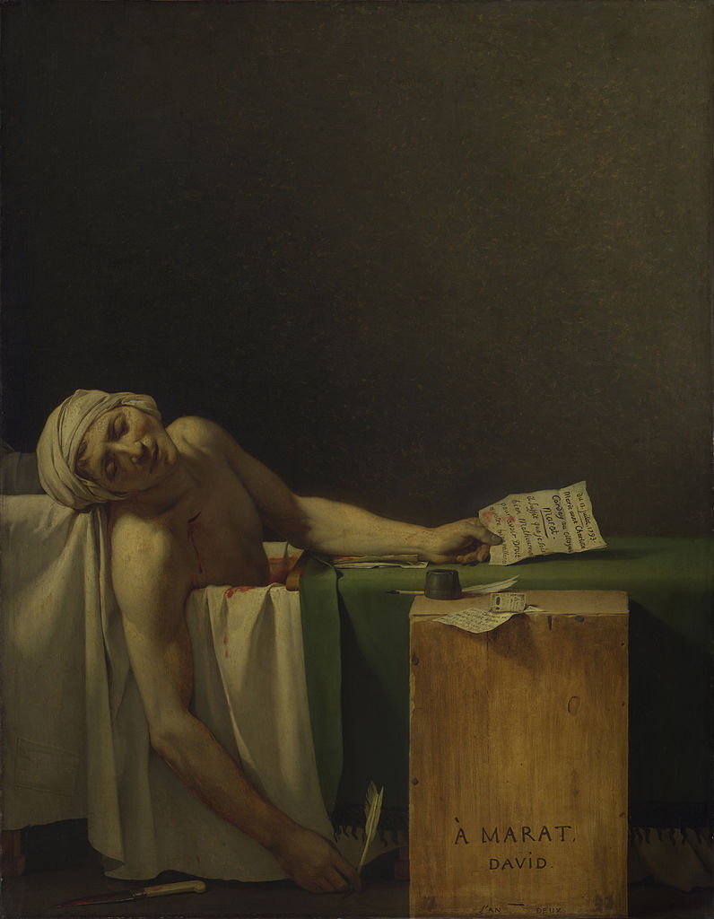 Marat, dead in his bathtub. A blanket is pulled over the tub, but some of the water is shown to be bright red. Marat still holds a letter in one hand and a quill in the other.