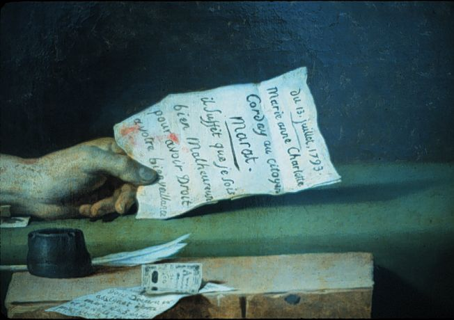 Marat's hand holding the letter. There is blood on the letter, which can clearly be read.