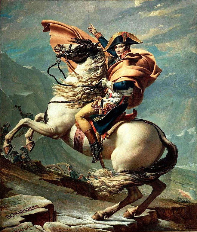 Napoleon on horseback. The horse is rearing up on its hind legs, and Napoleon is pointing off into the distance. His gaze is straight at the viewer of the painting.