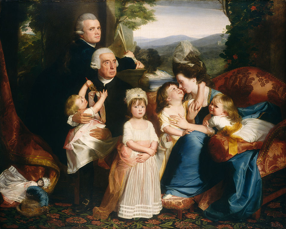 The portrait features husband and wife, four children, and an older man.
