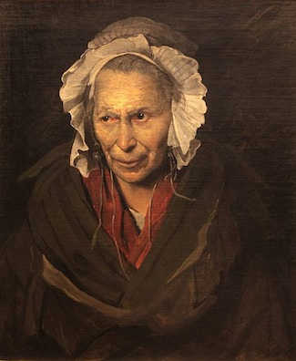 An elderly woman wearing a white bonnet. She wears a brown cloak over red clothing. Her eyes look to the side, focused on something the view cannot know.